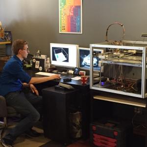 Karl with his 3D printer. He built it himself.